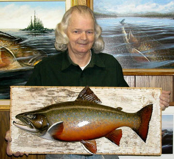 Artist David A. Footer with wood carving of Labrador Brook Trout